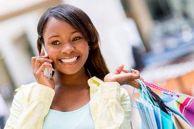 shopping_woman_talking_phone_mall_cg4p6756696c_th