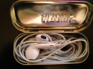 Earbuds in Altoids tin
