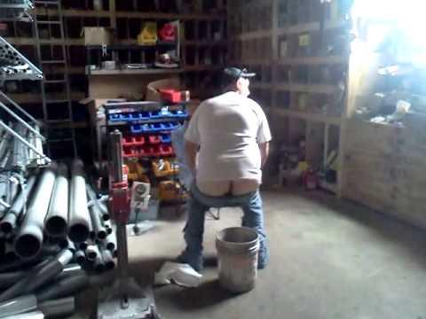 Man Pooping in Bucket
